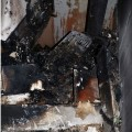 Vyhořelý obytný prostor vinného sklepa     Foto: pčr